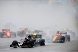 Romain Grosjean, Haas F1 Team VF-19, leads Carlos Sainz Jr., McLaren MCL34, and Nico Hulkenberg, Renault F1 Team R.S. 19