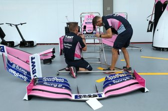 Mechanics work on the Lance Stroll Racing Point RP19 nose and front wing
