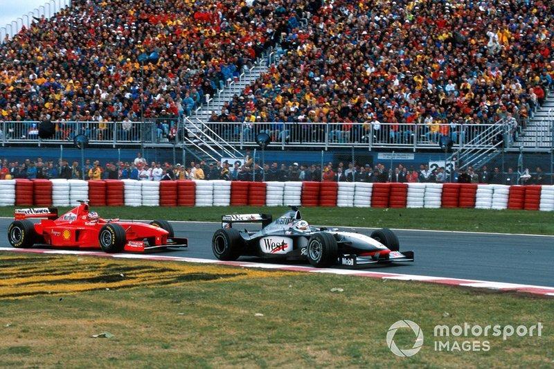 David Coulthard, McLaren MP4-13, leads Michael Schumacher, Ferrari F300