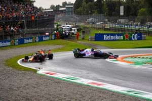 Alexander Albon, Red Bull Racing RB15, passes as Pierre Gasly, Toro Rosso STR14, spins
