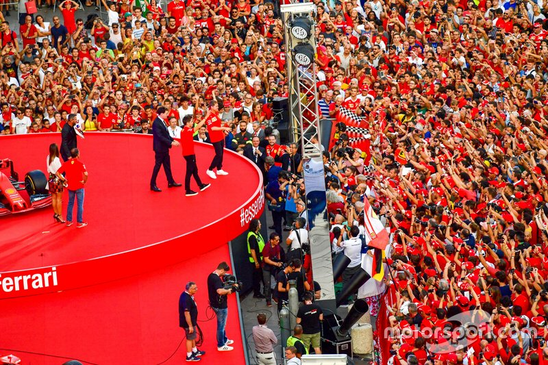 Charles Leclerc, Ferrari and Sebastian Vettel, Ferrari wave to the crowd from the stage