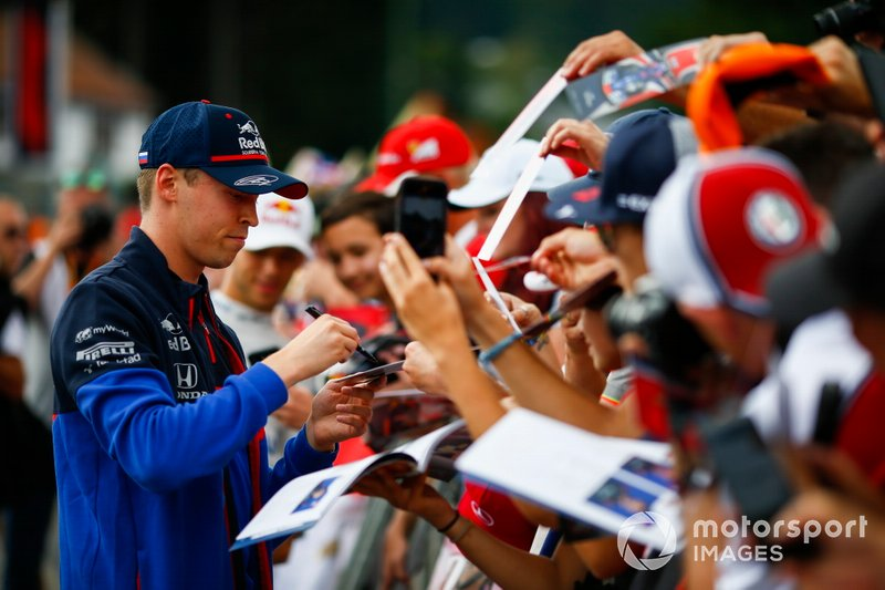 Daniil Kvyat, Toro Rosso, signs autographs for fans