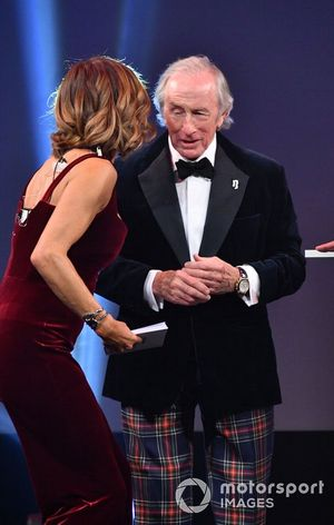Natalie Pinkham, Sky TV, and Sir Jackie Stewart, on stage to present a Gregor Grant Award