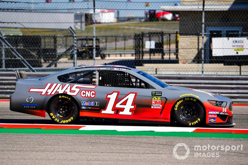 Kevin Magnussen, Haas F1 Team, and Romain Grosjean, Haas F1 Team, take it in turns to ride in a NASCAR with Tony Stewart