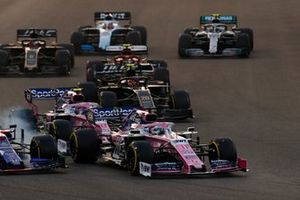 Sergio Perez, Racing Point RP19, Lance Stroll, Racing Point RP19 and Pierre Gasly, Toro Rosso STR14 make contact
