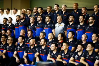 The Toro Rosso team pose for a group photo, including Masashi Yamamoto, General Manager, Honda Motorsport, Franz Tost, Team Principal, Toro Rosso, Mario Isola, Racing Manager, Pirelli Motorsport and Toyoharu Tanabe, F1 Technical Director, Honda