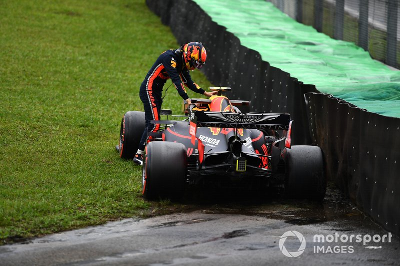 Alexander Albon, Red Bull Racing, climbs out of his car after losing control during practice