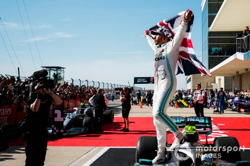Lewis Hamilton, Mercedes AMG F1, 2nd position, celebrates with a Union flag in Parc Ferme after securing his sixth world drivers championship title