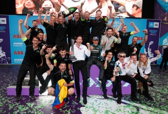 The Jaguar team celebrate victory on the podium