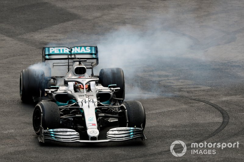 Lewis Hamilton, Mercedes AMG F1 W10, 1st position, performs donuts after winning the race