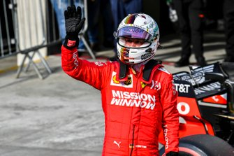Sebastian Vettel, Ferrari, waves to fans after Qualifying on the front row