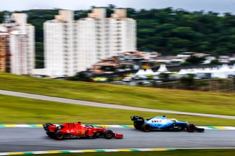 George Russell, Williams Racing FW42, leads Sebastian Vettel, Ferrari SF90
