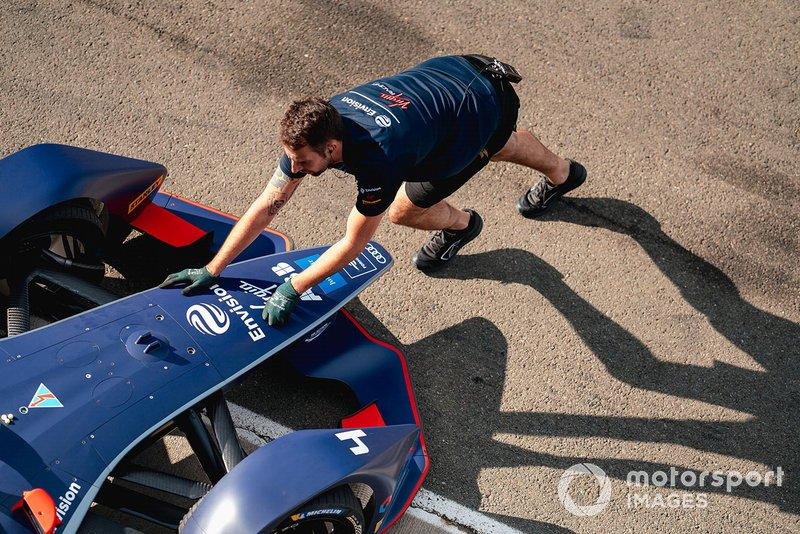 A mechanic pushes Robin Frijns, Envision Virgin Racing, Audi e-tron FE06 back into the garage