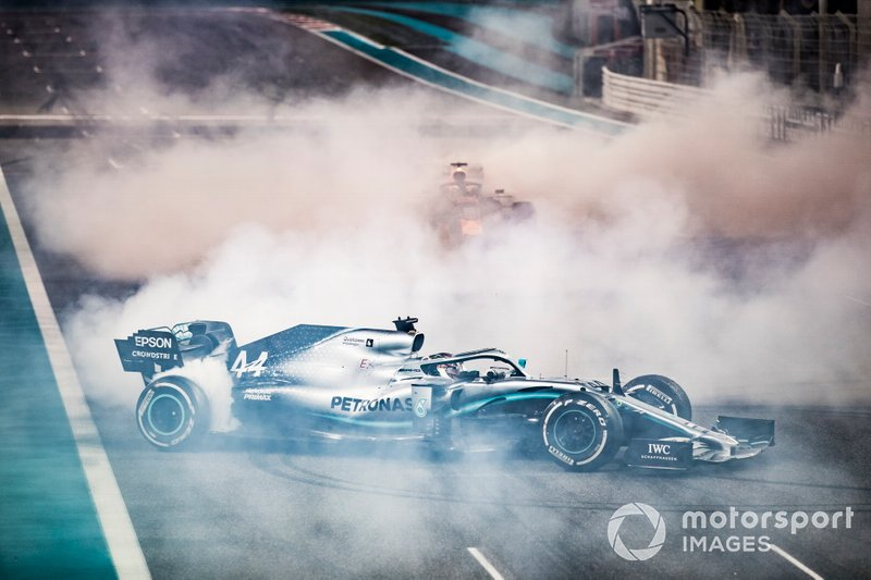 Max Verstappen, Red Bull Racing RB15, 2nd position, and Lewis Hamilton, Mercedes AMG F1 W10, 1st position, perform donuts