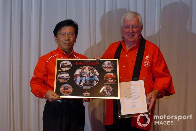 Andrew Cowan receives a citation for his work with Mitsubishi