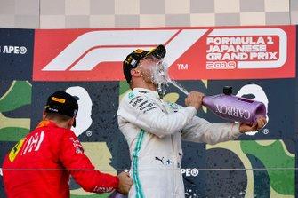 Sebastian Vettel, Ferrari, 2nd position, and Valtteri Bottas, Mercedes AMG F1, 1st position, celebrate on the podium with Champagne