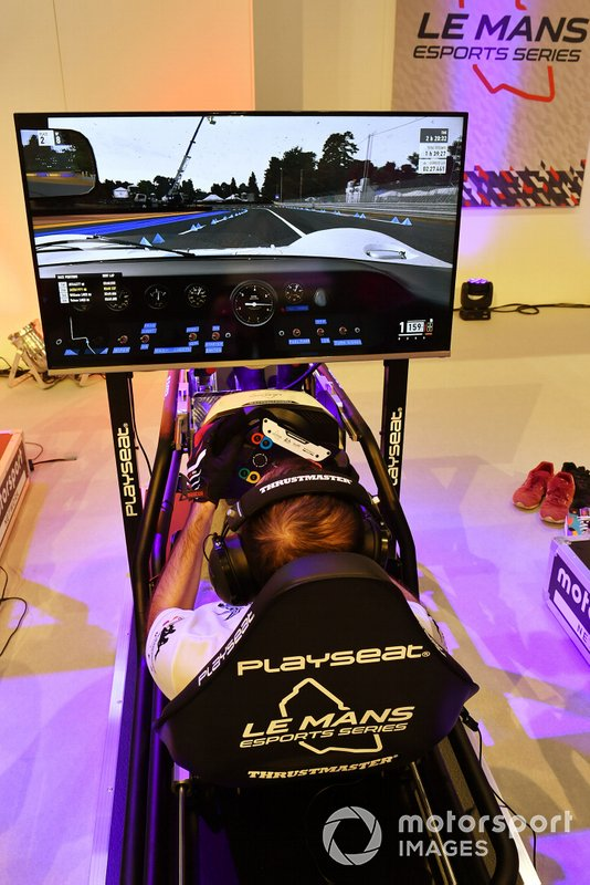 A fan enjoys the simulator rig on the Le Mans eSports Series stand