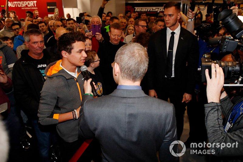 Lando Norris, McLaren talks to Stuart Codling before opening Autosport International 2020