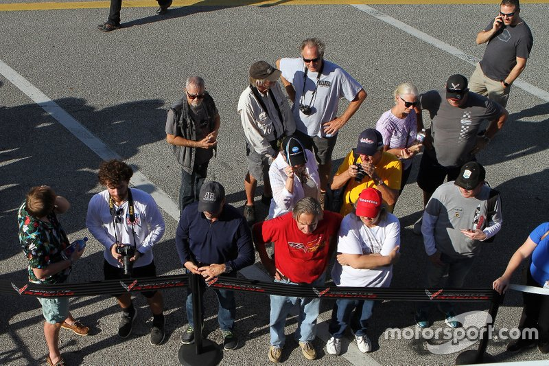 Fans observe the new Corvette race cars in the garage