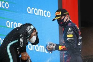 Max Verstappen, Red Bull Racing, 2nd position, sprays Lewis Hamilton, Mercedes, 1st position, with Champagne on the podium