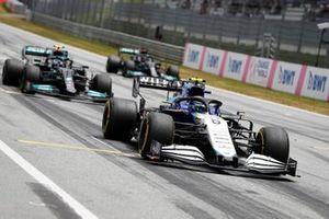 Nicholas Latifi, Williams FW43B, Valtteri Bottas, Mercedes W12, and Lewis Hamilton, Mercedes W12