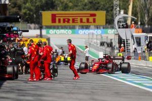 Mechanics outside the Ferrari garage as Charles Leclerc, Ferrari SF21, returns