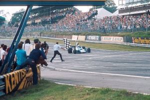 Jody Scheckter, Tyrrell 007 Ford, takes the chequered flag for 1st position