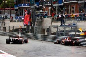 Carlos Sainz Jr., Ferrari SF21, passes as Charles Leclerc, Ferrari SF21, crashes out at the end of Qualifying