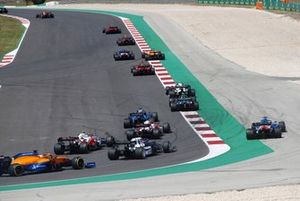 Fernando Alonso, Alpine A521, runs wide ahead of Kimi Raikkonen, Alfa Romeo Racing C41, Antonio Giovinazzi, Alfa Romeo Racing C41, Yuki Tsunoda, AlphaTauri AT02, and Daniel Ricciardo, McLaren MCL35M