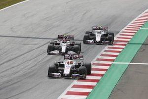 Nikita Mazepin, Haas VF-21, Antonio Giovinazzi, Alfa Romeo Racing C41, and Mick Schumacher, Haas VF-21