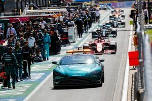 The Safety Car Charles Leclerc, Ferrari SF21, Lewis Hamilton, Mercedes W12, and the rest of the field through the pit lane