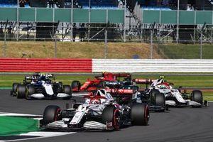 Kimi Raikkonen, Alfa Romeo Racing C41, Lance Stroll, Aston Martin AMR21, and Antonio Giovinazzi, Alfa Romeo Racing C41