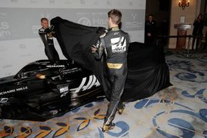 Romain Grosjean, Haas F1 Team and Kevin Magnussen, Haas F1 Team unveil the Haas Livery ]