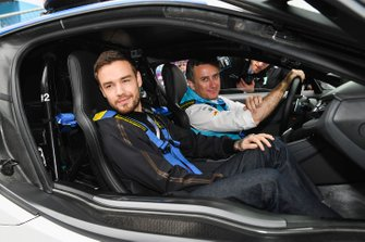 Singer Liam Payne on a hot lap with Alejandro Agag, CEO, Formula E in th BMW i8 Safety car