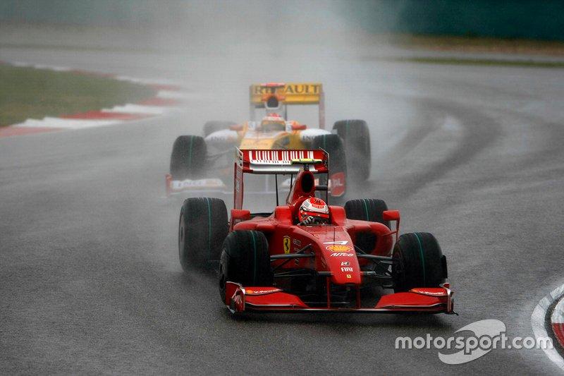 Kimi Raikkonen, Ferrari F60, leads Fernando Alonso, Renault R29