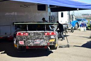 Crew work on the #91 TA2 Chevrolet Camaro driven by Joe Napoleon of Napoleon Motorsports