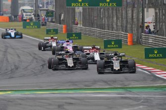 Romain Grosjean, Haas F1 Team VF-19, leads Kevin Magnussen, Haas F1 Team VF-19, Kimi Raikkonen, Alfa Romeo Racing C38, Lance Stroll, Racing Point RP19, Antonio Giovinazzi, Alfa Romeo Racing C38, and Robert Kubica, Williams FW42, on the opening lap