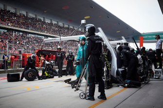 The Mercedes pit crew ready for a stop