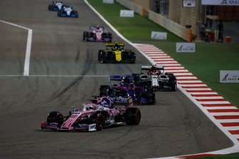 Sergio Perez, Racing Point RP19, leads Daniil Kvyat, Toro Rosso STR14, Antonio Giovinazzi, Alfa Romeo Racing C38, and Nico Hulkenberg, Renault R.S. 19