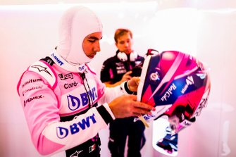 Sergio Perez, Racing Point, puts his helmet on