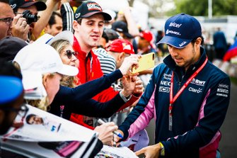 Sergio Perez, Racing Point, signs autographs for fans