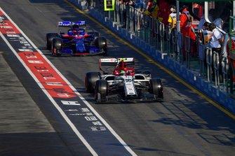 Antonio Giovinazzi, Alfa Romeo Racing C38, leads Daniil Kvyat, Toro Rosso STR14, in the pit lane