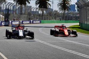 Sebastian Vettel, Ferrari SF90, passes Kimi Raikkonen, Alfa Romeo Racing C38