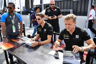Romain Grosjean, Haas F1 and Kevin Magnussen, Haas F1 sign autographs for fans