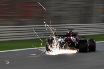 Sparks fly from the car of Kimi Raikkonen, Alfa Romeo Racing C38