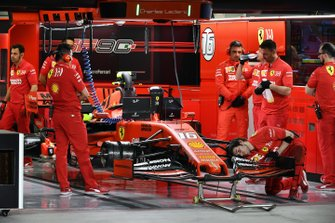 Mechanics work on the car of Charles Leclerc, Ferrari SF90, in the garage