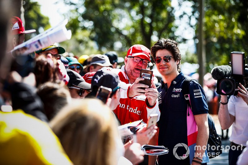Lance Stroll, Racing Point poses for a selfie with a fan