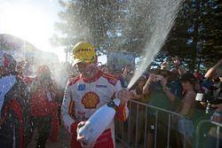 Race winner Scott McLaughlin, Team Penske Ford celebratres with champagne