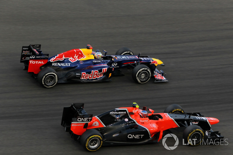 Sebastian Vettel, Red Bull Racing RB8 passes Charles Pic, Marussia F1 Team MR01