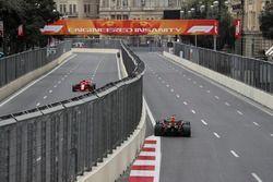 Kimi Raikkonen, Ferrari SF71H amd Max Verstappen, Red Bull Racing RB14